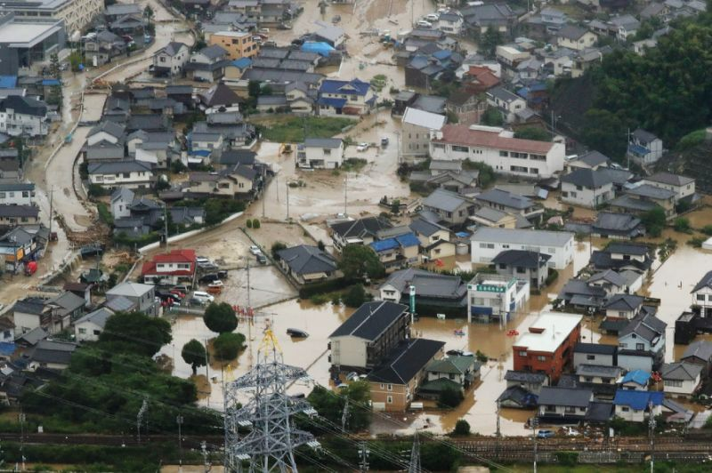 Toll nears 60 as Japan scrambles to rescue flood victims