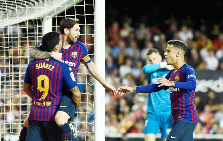 Messi's brilliant equaliser helps Barcelona to a 1-1 draw with Valencia