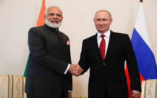US, China look on as Putin seeks India arms deals