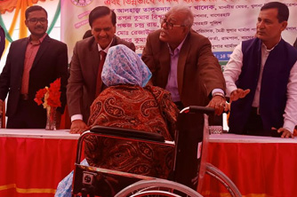 Water filters and wheel chair distributed at Rampal