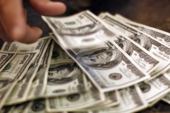 US economists less optimistic, see slower growth: survey