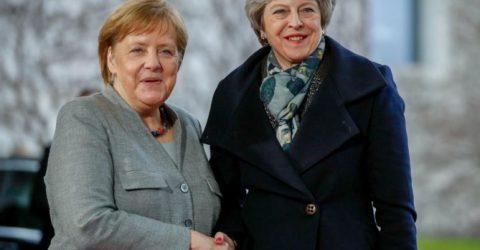 Britain's May seeks Brexit delay from Merkel, Macron
