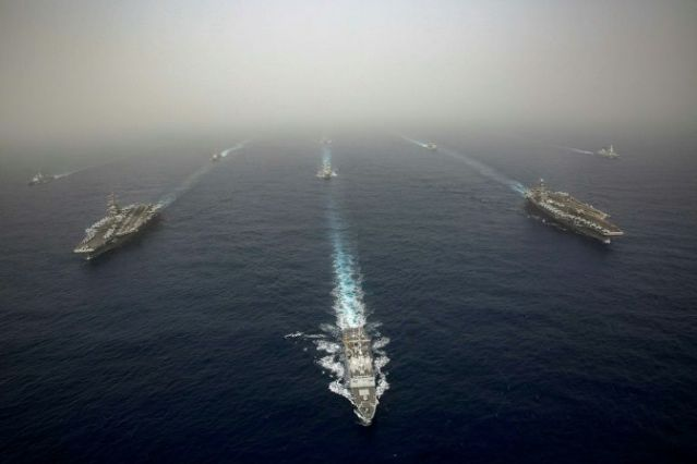 US sends naval strike group as tensions rise with Iran