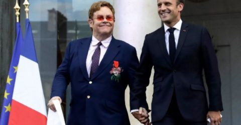 Hand-in-hand, Macron and Elton John join forces on AIDS