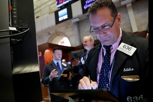 Wall Street swings to split finish; notches weekly gains
