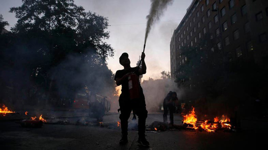 Chile president declares state of emergency after violent protests