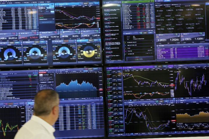 Global stocks mostly down on trade war, Brexit worries