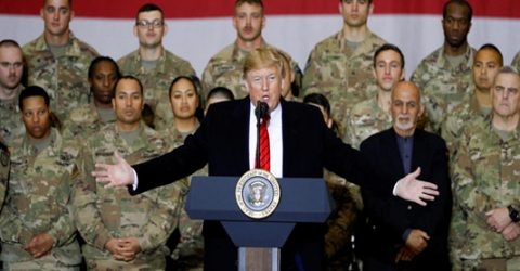 Trump visits troops in Afghanistan, says Taliban talks back on