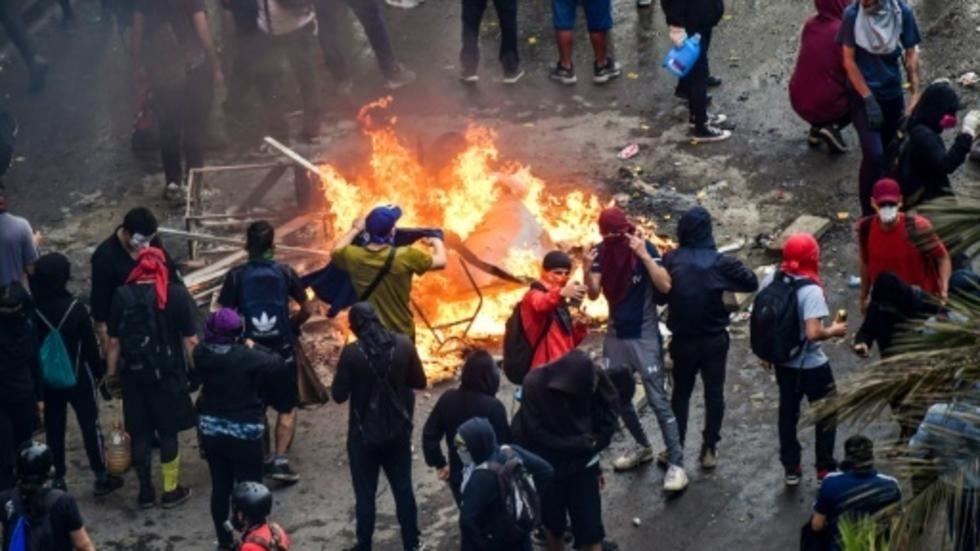Protesters in Chile set fire to university, loot church