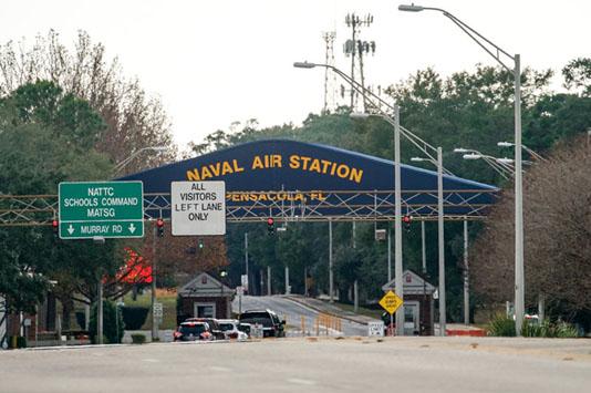 Gunman at US military base showed mass shooting videos at party: report