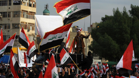 Iraq protesters turn out in defiance after Baghdad attack