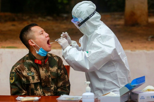Virus death toll surges as China changes way it counts cases