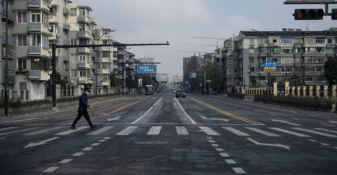 More Chinese cities shut down as virus death toll rises