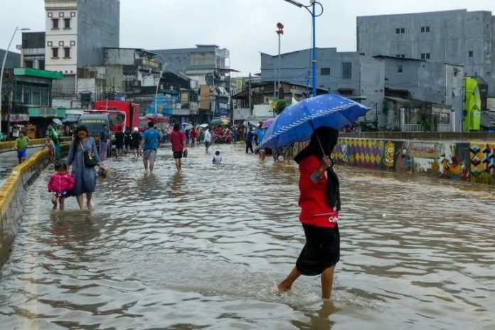 Torrential rains flood Indonesia capital