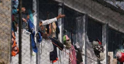 Prison riot kills 23 in Colombia as Chile enforces virus curfew
