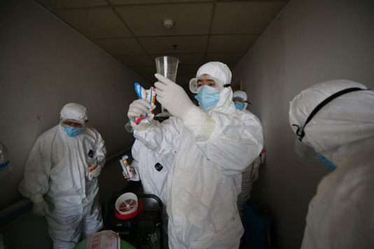 China reports no new domestic virus cases for first time, but 34 imported