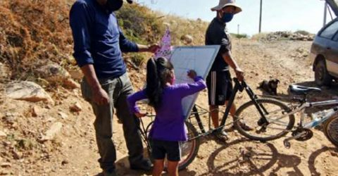 Bolivian teacher on a bike brings school to pupils