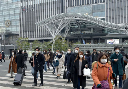 Japan to expand virus emergency to seven more regions