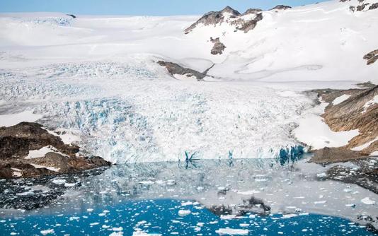 Changing snowfall making Greenland darker and warmer: study