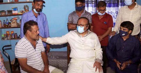 Liton stands besides boxing hero Mosharraf in Rajshahi